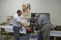 Phil Sterritt and Ron Norwood setting up displays